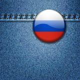 Ryskt flaggaemblem på grov bomullstvilltygtextur Fotografering för Bildbyråer