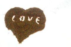 Rysować na lekkiej pokazu literowania miłości na barwionym piasku Fotografia Royalty Free