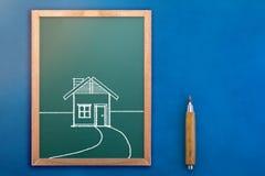 Rysować dom na chalkboard jpg Obrazy Royalty Free