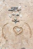 Rysować na piasku Zdjęcia Stock