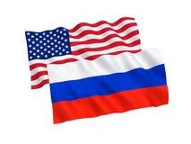 Ryss och amerikanska flaggan Fotografering för Bildbyråer