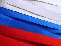 Ryssland flagga eller baner Arkivfoto