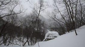 Ryssland republik av norr Ossetia, Alania Filmvintersnöstorm i bergen av det centrala Kaukasuset arkivfilmer