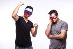 Ryssland vs England Fotbollsfan av landslag visar sinnesrörelser: England förlorar, den Ryssland segern Arkivbild