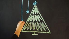 Rysuje choinki z kredą na łupku Nowego Roku kartka z pozdrowieniami sztandaru Plakatowy szablon zbiory