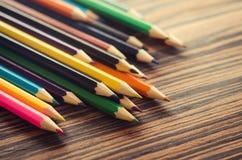 Rysunkowi ołówki na tle Fotografia Royalty Free