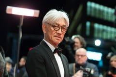 Ryuichi Sakamoto på röd matta för utmärkelseceremonin av den 68th Berlinalen Royaltyfri Fotografi