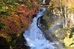 Ryuzu (Dragon Head) Waterfall. Ryuzu no Taki, literally means Ryuzu Waterfall. One of the most famous waterfall in Japan, is photographed in autumn. A rainbow Royalty Free Stock Photography