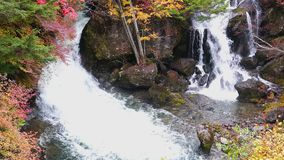 Ryuzu Waterfalls with the beautiful autumn color of the foliage