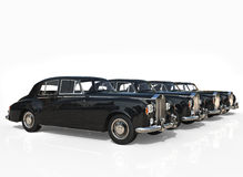 Rząd Czarni roczników samochody na białym tle Obrazy Royalty Free