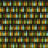 Rzędy różne butelki na czarnym tle Zdjęcia Stock