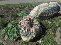 Rzeźba motyl na skale Obraz Royalty Free
