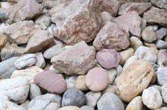 Rzeczni otoczaki i inny kamienie Obrazy Stock
