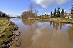 Rzeka biega w morze Zdjęcia Royalty Free