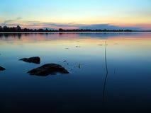 Rzeka przy zmierzchem Zdjęcia Stock