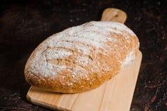 Rzemieślnika chleb na czarnym tle zdjęcie royalty free