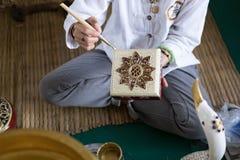 rzemieślnika obrazu złocisty kolor na pamiątkarskim prezenta pudełku Zdjęcia Royalty Free