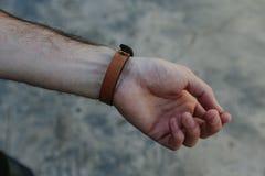 Rzemienna patka na ręce zdjęcie royalty free