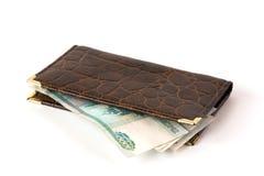 Rzemienny portfel z pieniądze odizolowywającym Zdjęcie Royalty Free