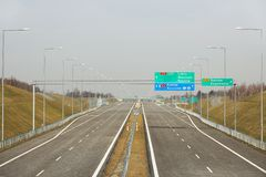 Rzeszow, Poland - 3 3 2019: Two-lane motorway with signposting signs. New road without cars. The development of transport. Infrastructure. Landscape design of stock photography