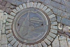 Rzeszow, Polen - een prachtig rioleringsbroedsel met een kasteelpatroon stock afbeelding