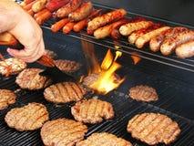 rzucić hamburgery Zdjęcie Stock