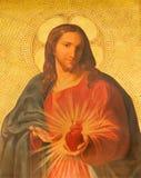 Rzym - farba serce Jezus na bocznym ołtarzu w kościelnym bazyliki dei Santi XII Apostoli niewiadomym artystą 19 cent Zdjęcie Stock