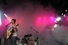 Sábado Sun que se realiza en el festival 2014 de la voltereta Foto de archivo libre de regalías