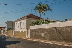 Working-class old house with wall in an empty street on a sunny day at São Manuel. royalty free stock photography