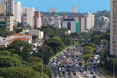 São Paulo has a huge problem with vehicular traffic. São Paulo: Brazil, November 2015. Rush hour and the vehicular traffic. Buildings, cars and trees Stock Photo