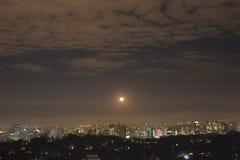 São Paulo at night. Moon on the São Paulo skyline stock photography