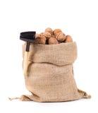 Säck med valnötter och nötknäpparen Arkivfoto
