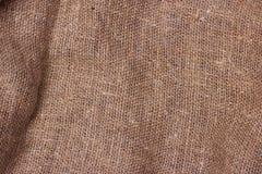 Säckväv texturerad bakgrundsbrunt Arkivfoto