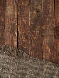 Säckvävtextur på gammal trätabellbakgrund Trätabell med att plundra arkivfoton