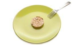 sädes- dietary grön bakelseplatta royaltyfri foto