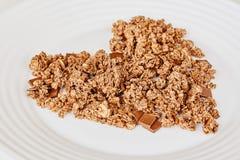 Sädes- myslifrukost på vit bakgrund Sunt äta och livsstilbegrepp royaltyfri foto