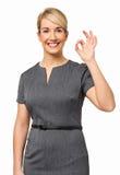 Säker affärskvinna With Okay Gesture Royaltyfri Bild