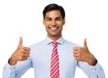 Säker affärsman Gesturing Thumbs Up Royaltyfri Bild