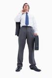 Säker detaljhandlare med resväska och omslaget Arkivbild