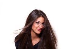 Säker kvinna med långt le för hår Royaltyfria Foton