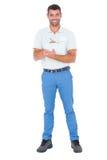 Säker manlig arbetsledarehandstil på skrivplattan över vit bakgrund arkivbild