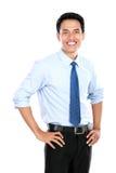 Säker ung affärsman som ser kameran arkivfoton