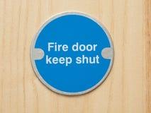 säkerhet för brandplatta Arkivbild