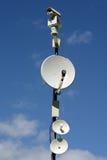 Säkerhet och satellitsystem Arkivfoto