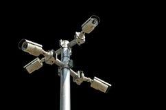 Säkerhetskamera som isoleras på svart bakgrund Fotografering för Bildbyråer