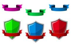 Säkerhetssymboler med sköldar och band Arkivbild