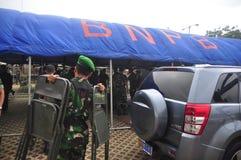 Säkra den gemensamma ankomsten för den personalGafatar medlemmen på porten av Tanjung Emas Semarang Arkivbilder