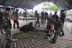 Säkra den gemensamma ankomsten för den personalGafatar medlemmen på porten av Tanjung Emas Semarang Royaltyfri Fotografi