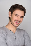 Säkra unga män! Stående av säkra unga män som ler på Fotografering för Bildbyråer