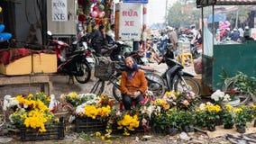 Sälja blommor på mån- ny ferie för år-Tet Royaltyfri Foto